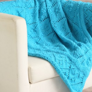 556064aeda3e Featuring clusters of bobble-like structures nestled in the center of lace  blocks  this turquoise baby blanket is the perfect way to brighten up ...