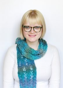 woman wearing a blue knitted scarf
